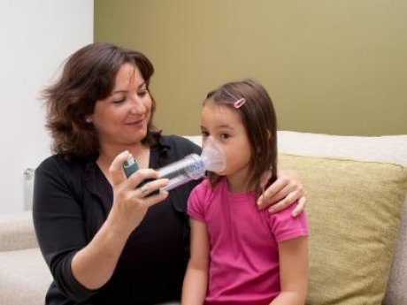 mother and child with asthma at home