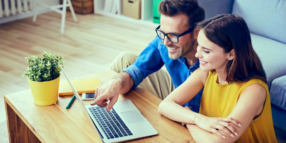 couple looking at houses online