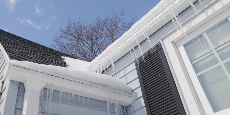 Ice damns forming on the outside of a house